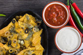 Mexican hot street food nachos with salsa dip — Stock Photo