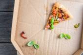 Leftovers slices of homemade vegetarian pizza in box — Stock Photo