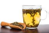 Aromatic antioxidant green tea on wooden board, isolated backgro — Foto de Stock