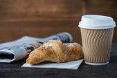 Take away coffee and fresh croissant and newspaper — Stock Photo