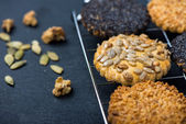Homemade healthy cookie with seeds on cooling tray — Stock Photo