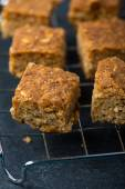 Homemade healthy flapjacks with honey on cooling rack — Stock Photo