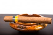 Cuban cigar isolated on wooden bar and white background — Stock Photo