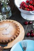 Homemade cherry pie served on rustic table — Stock Photo