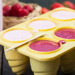Filling ice cream moulds with homemade juice — Stock Photo #72950777
