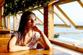 Young woman in cafe near sea — Stock Photo