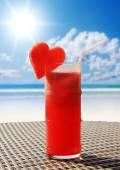 Fruity cocktail on a beach table — Stock Photo