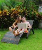 Happy smiling couple surfing internet — Stock Photo