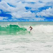 Athletic surfer with board — Stock Photo