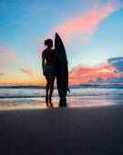 Young woman surfer with board — Stock Photo