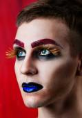 Handsome young man fashion model with make-up — Stock Photo