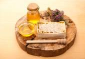 Honey, honey comb and dried herbs — Stock Photo