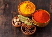 Spices Over Wood.  Curry, paprika, nutmeg, cardamom, bay leaf, anis. — Stock Photo