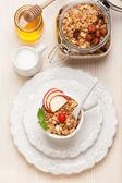 Granola muesli with honey and milk. Healthy breakfast. — Stock Photo