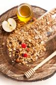 Homemade granola with nuts, dried fruit and honey on wooden background — Stock Photo