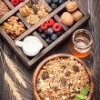 Granola muesli with berries, honey, nuts and milk. foods for breakfast — Stock Photo #55609827