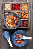Muesli granola oatmeal with nuts and dried fruits. Healthy breakfast. Top view. — Stock Photo