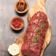 Roast beef with spices and rosemary. top view — Stock Photo #65382039