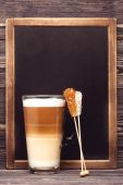 Cappuccino and menu board — Stock Photo
