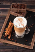 Cappuccino with cinnamon on a chalk board menu. top view — Stock Photo