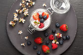 Chia seeds pudding with coconut milk and fresh summer berries. top view — Stock Photo