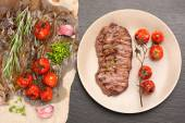 Meat Ribeye steak entrecote with roasted tomatoes and herbs — Stock Photo