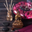 Spa aromatherapy meditation. Buddha statue, essential oils, incense sticks and stones massage — Stock Photo #76784149