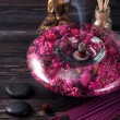 Spa aromatherapy meditation. Buddha statue, essential oils, incense sticks and stones massage — Stock Photo #76799585