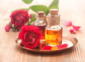 Rose essential oil, sea salt and rose flowers. Body Care and Spa — Stock Photo