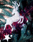 Christmas tree decorated with toys deer — Stock Photo