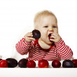 Baby Eating Plums — Stock Photo #53641299