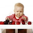 Baby Is Selecting Plums — Stock Photo #53641443