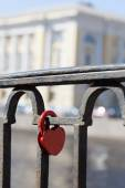 The red lock on a fencing  — Stock Photo