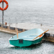 Boat under the summer rain tied to the pier — Stock Photo #53647679