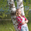 Portrait of a beautiful young woman resting near the lake — Stock Photo #54736753