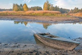 Autumn river and blue old rowing boat — Stock Photo