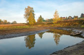 Small river flowing near the village autumn morning — Stock Photo