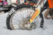 Wheel racing bike in the snow — Stock Photo