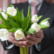 Man - businessman in a suit gives a bouquet of flowers, white tu — Stock Photo #66396719