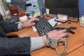 Office worker chained to the workplace — Stock Photo