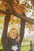 Woman hanging on branch — Foto de Stock