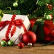 Closeup of gifts under a tree — Stock Photo #58230789