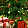 Christmas gifts under a tree — Stock Photo #58230853