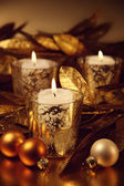 Closeup of candles lit with a sparkling gold theme — Stock Photo