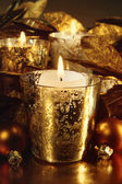 Candles lit with a sparkling gold theme — Zdjęcie stockowe