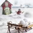 Wooden sled and snowballs with wintery background — Stock Photo #59817345