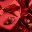 A group of red hearts on satin background — Stock Photo #62890383