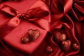 A group of red hearts on satin background — Foto Stock