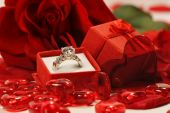 Red hearts and rose with wedding ring — Stock Photo