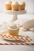 Sweet vanilla cupcake with straws — Stock Photo